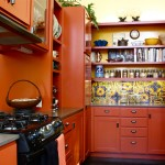 Gorgeous-Mexican-Tiles-fashion-Santa-Barbara-Southwestern-Kitchen-Inspiration-with-apron-sink-black-stove-Colorful-Tile-drawer-pulls-farm-sink-glass-front-cabinets-gray