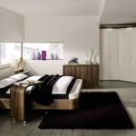 Interior-Bedroom-Decoration-With-Latest-Corner-Closet-Decorating-Ideas-And-Black-Large-Rugs-Under-Modern-Beds-Design-Also-Using-Wood-Flooring-Decorative-615x315