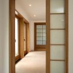 Simple-Wooden-Frame-for-Wide-Sliding-Interior-Doors-in-Minimalist-House-Hallway-with-White-Wall