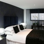 Sophisticated-contemporary-bedroom-in-London-clad-mainly-in-black-and-white