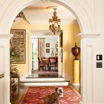 tradiational-home-Suzy-q-better-decorating-bible-blog-arches-provincial-traditional-look-yellow-walls-Persian-carpet-banister-stairs-orange-walls-mural-black-1
