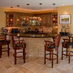 classic-basement-bar-design-ideas-with-modular-curved-kitchen-island-table-below-track-pendant-lamp-shade-along-with-contemporary-wall-picture-aside