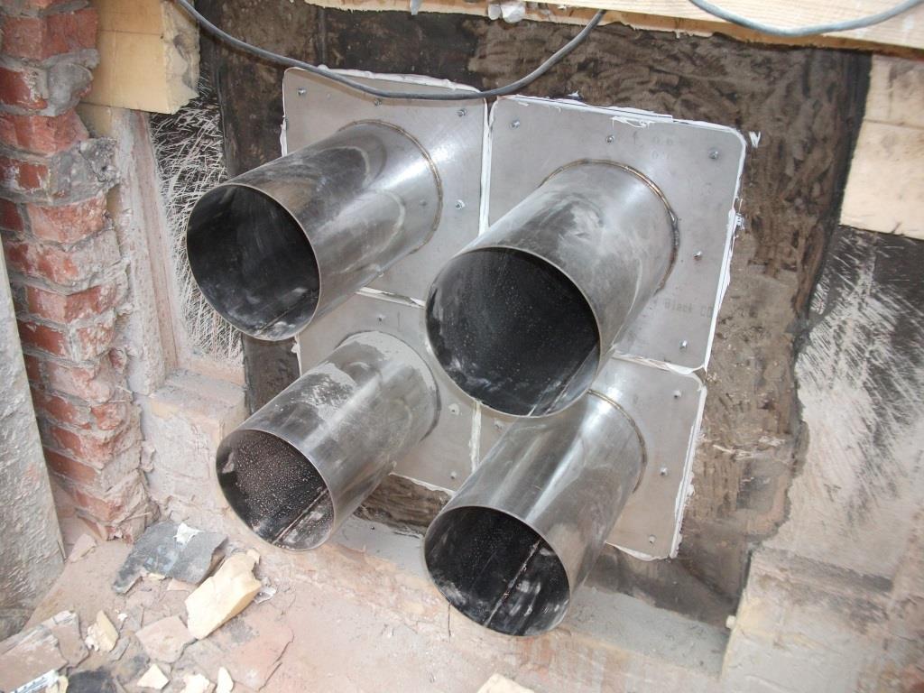 идея использования гильзы для прохода труб в отделке стен